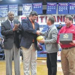 Riggs presents golden ball to SHS