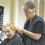 Beautician puts away clippers