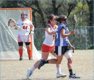 Lady Knights lacrosse pulls off first win